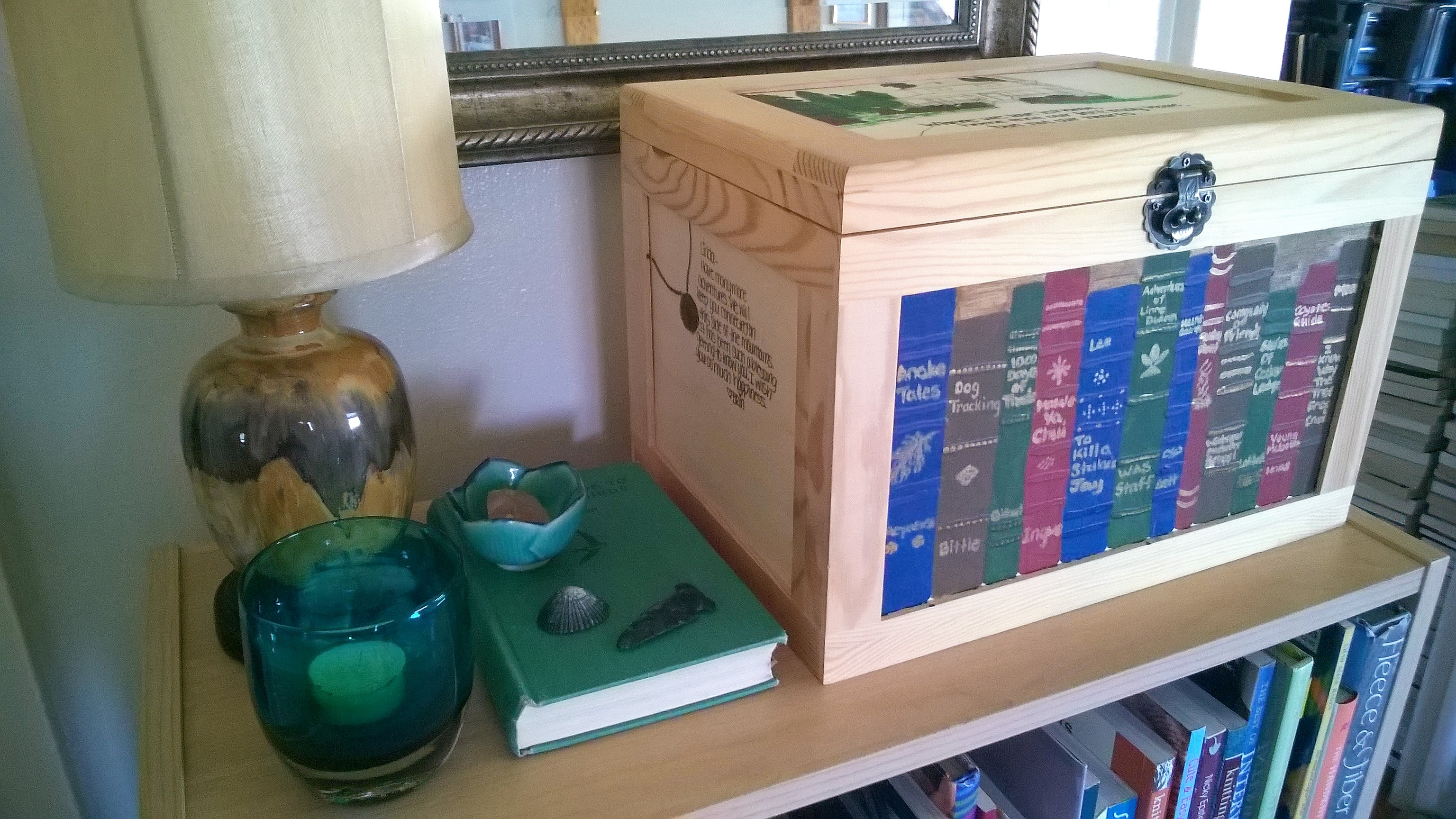 Even the wooden box on the shelf had books painted on the front! Sill life with lamp, candles, and trinkets.