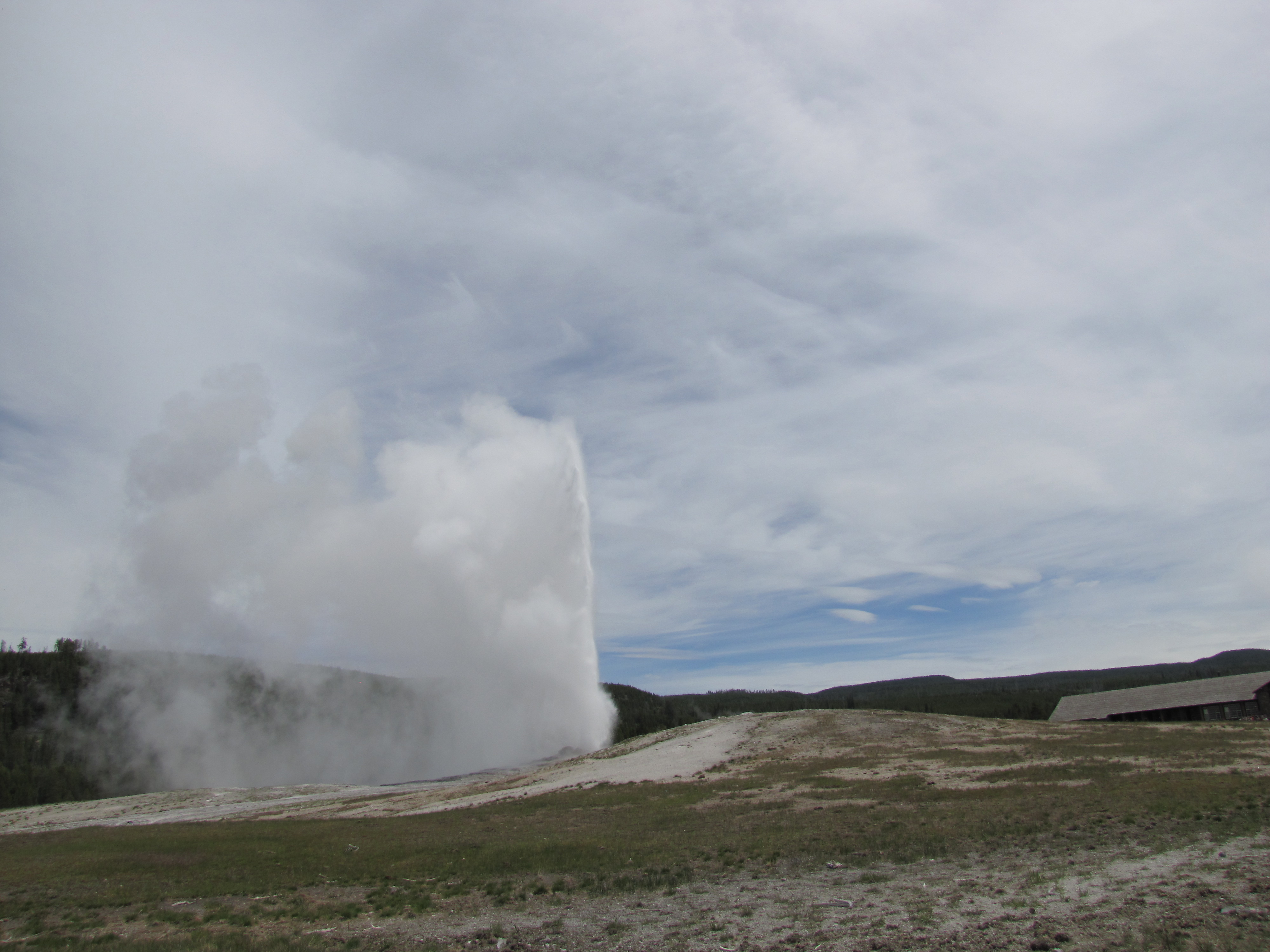 Old Faithful erupts on a cloudy June day. I found a spot near the edge of the boardwalk so my view was not obstructed.