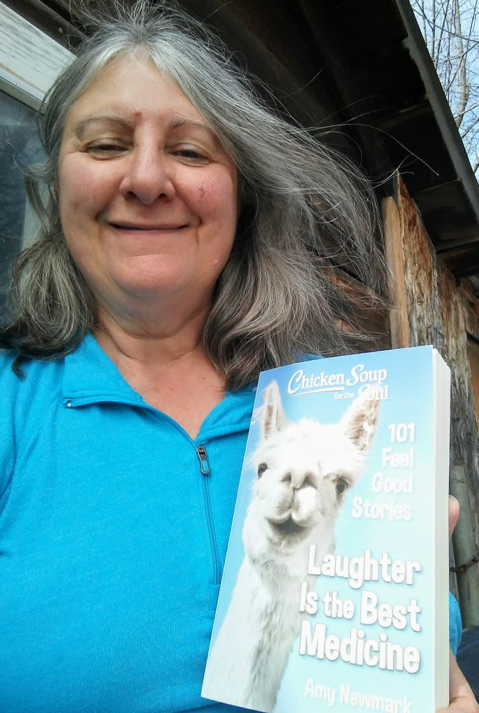 Author Linda Bittle holding an advance copy of the latest Chicken Soup for the Soul title, Laughter is the Best Medicine.